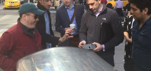 Assistant Professor Constantine Kontokosta (second from right) works with sensors developed by his lab that generate data to better understand how cities work.