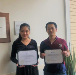 Rufei Sheng and Zhu Wang with awards